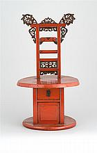 RARE RED LACQUER FOOT-BINDING STAND Tori-form top support with roller and carved details of ruyi and bat design. Circular base with...