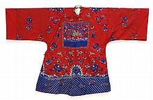 LADY'S EMBROIDERED RED SILK JACKET With bird and flower design about two needlework rank badges.