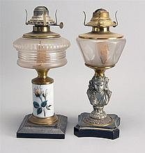 TWO 19TH CENTURY FLUID LAMPS in glass and metal. One with painted floral stem and one with figural base. Heights 11½