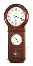 20TH CENTURY HOWARD MILLER REGULATOR WALL CLOCK in a mahogany case. Concave glass lens over upper clock face surrounded by molded be...