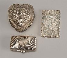 THREE SILVER BOXES: two English sterling including one in heart form with floral design and a card case with foliate engraving, and...
