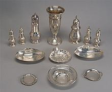 THIRTEEN STERLING SILVER AND SILVER PLATED HOLLOWWARE ITEMS by various makers. Includes: weighted vase, two pairs of salt & pepper s...