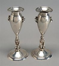 PAIR OF STERLING SILVER VASES BY BALL, BLACK & CO. OF NEW YORK In an Egyptian motif of urn-form vases resting on kneeling Egyptian f...