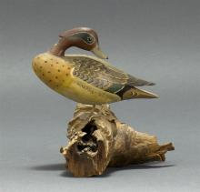 MINIATURE GREEN-WINGED TEAL DRAKE By James Lapham of Dennisport, Massachusetts. In preening form. Mounted on a driftwood base. Signe...