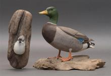 TWO DECORATIVE BIRD CARVINGS A titmouse and a mallard drake, both by Randy and Elaine Fisher of Dennis, Massachusetts. Mounted to dr...