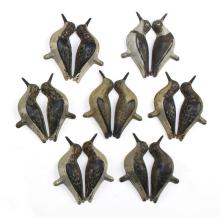 SET OF SEVEN TIN SANDERLING DECOYS By Strater & Sohier Decoys Company of Boston. Five matching and two differing. Minor paint loss.