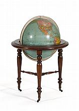 GLOBE ON STAND Made by Replogle Globes. Mahogany stand with casters. Height 32