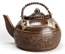 COCONUT SHELL TEAPOT In ovoid form with decoration of Buddhistic symbols. Diameter 4.75
