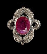 WHITE GOLD, DIAMOND, AND RUBY RING With faceted ruby (approx. 11.5 mm). Size 7¼.