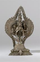 SILVERED-BRONZE FIGURE Depicting an eleven-headed, thousand-armed figure standing on a stepped lotus base with elaborate mandala. He...
