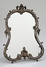 CONTINENTAL DRESSER MIRROR WITH SILVER PLATED FRAME In a rococo design. Swing-out support on back. Height 26.25