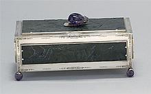 EDWARD I. FARMER STERLING SILVER AND JADE BOX Five panels of spinach green jade with floral design. Amethyst peach-form finial and f...