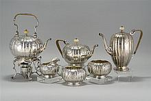 SIX-PIECE STERLING SILVER TEA AND COFFEE SET BY DURGIN, DIV. OF GORHAM MFG. CO. In melon form with engraved floral and swag design....