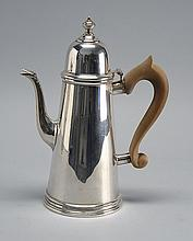 CURRIER & ROBY STERLING SILVER COFFEEPOT In lighthouse form with wooden C-shape handle and goose neck spout. Height 10