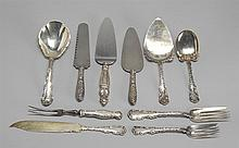 TEN STERLING SILVER SERVING PIECES By various makers. Includes a pie slice, a cake saw, small and large cold meat forks, and a small...