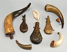 SEVEN POWDER FLASKS AND HORNS Together with two Civil War lead bullets. Includes a brass shell-design powder flask, four horn flasks...