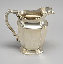 GORHAM MFG. CO. STERLING SILVER WATER PITCHER In an eight-panel form with a C-curve handle. Height 8.25