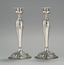 PAIR OF STERLING SILVER WEIGHTED CANDLESTICKS Marked on base