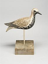 ELMER CROWELL-STYLE BLACK-BELLIED PLOVER DECOY By Jerome Howes of Putney, Vermont. Turned head with glass eyes. Carved wings.