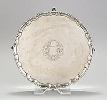 STERLING SILVER FOOTED SALVER BY TIFFANY After an original by Robert Abercromby. With shaped rim and engraved crest. Diameter 12