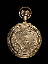14KT YELLOW GOLD HUNTER CASE POCKET WATCH By Waltham Watch Co. Seventeen-jewel movement. Case with engraved floral design. Serial #1...
