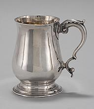 AMERICAN SILVER CANN In pear shape with molded flared rim and a molded circular splayed foot. Double scrolled handle with sprig deco...