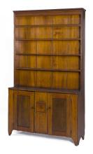 ANTIQUE AMERICAN STEP-BACK CUPBOARD In pine under an old brown stain. Molded shaped cornice over three shelves. Lower section with t...
