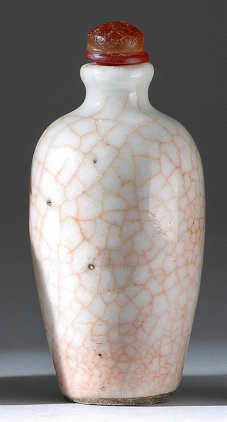 PORCELAIN SNUFF BOTTLE In inverted pear shape with rose crackle glaze. Height 2¾