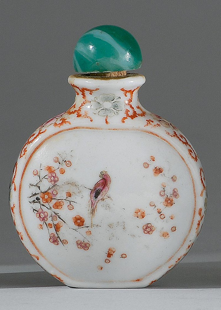 FAMILLE ROSE PORCELAIN SNUFF BOTTLE In ovoid form with bird and flower cartouches on a flower and vine ground. Four-character Qianlo...
