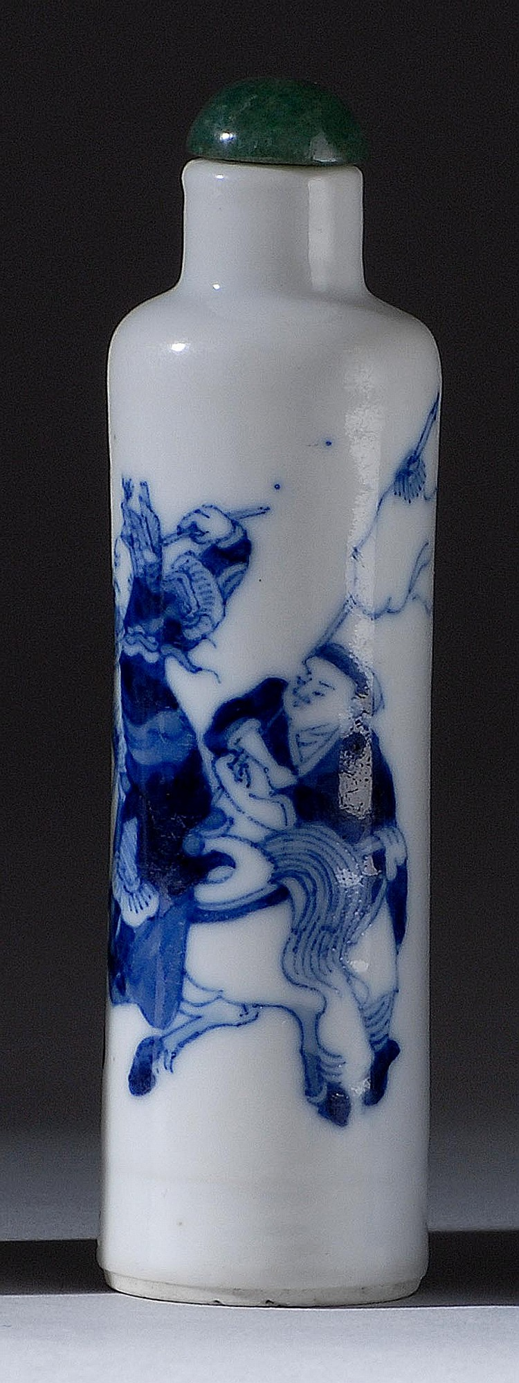 UNDERGLAZE BLUE PORCELAIN SNUFF BOTTLE In cylinder form with decoration of a mounted warrior and attendant. Height 3