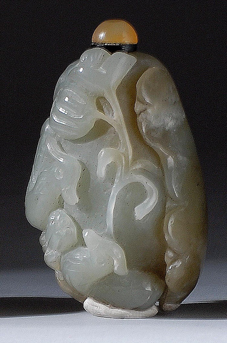 CELADON JADE SNUFF BOTTLE In pebble form with relief carving of mandarin ducks and lotus. Length 2