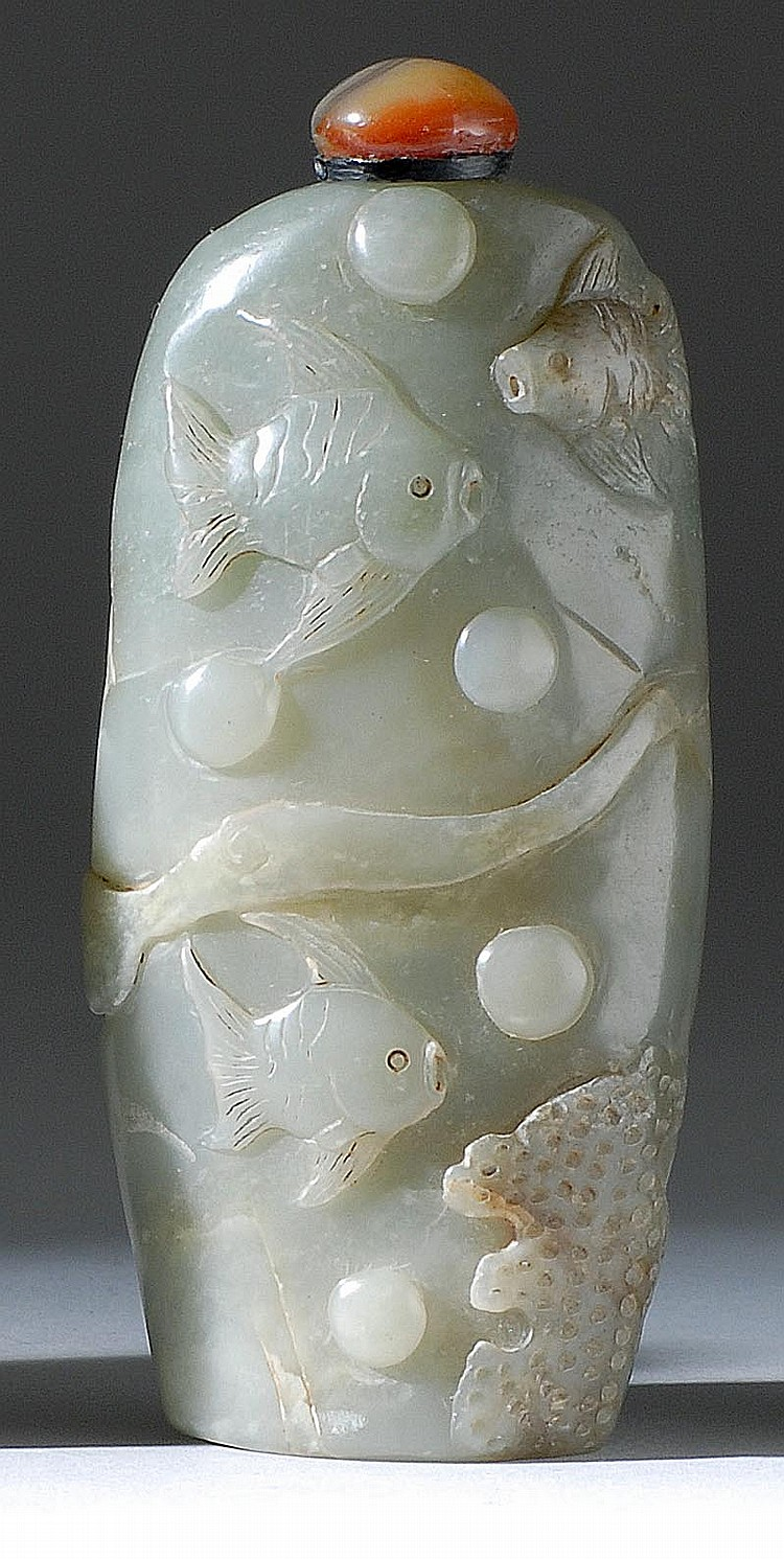 CELADON JADE SNUFF BOTTLE In modified cylinder form with fish and seagrass design. Height 3½