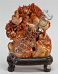 CARVED SOAPSTONE MOUNTAIN In rust-red and tan. Depicting birds and flowering trees. Height 5