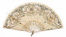 SILK AND MOTHER-OF-PEARL FOLDING FAN Silk leaf with three fine mesh insets with circular vignettes, two painted with a bow and quive...