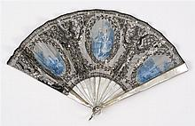 BLUE-GRAY SILK AND MOTHER-OF-PEARL FOLDING FAN Pierced and spangled gray silk fan with three painted vignettes: central depicts a co...