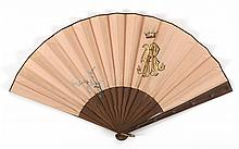 SILK AND WOOD FOLDING FAN Peach silk double leaf with illustration on front of a spray of forget-me-nots and a monogram surmounted b...