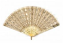 SILK, NET, AND BONE FOLDING FAN Pretty beige leaf of alternating squares of net and silk with gold and silver sequins and spangles....