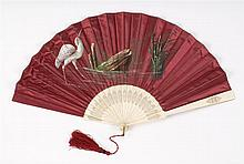RED SATIN AND BONE FOLDING FAN Red satin leaf painted with a white wading bird amongst reeds and a rock. Simple bone sticks and guar...
