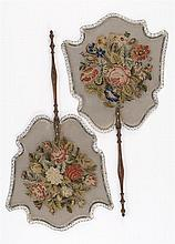 PAIR OF NEEDLEPOINT AND WIRE MESH FIXED HAND SCREENS Wire mesh screens in shield form worked in petit point wool scenes of bouquets...