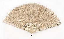 LACE AND BONE FOLDING FAN Large ribbon-style lace leaf with five medallions with flower centers. Slightly wavy bone sticks with gold...
