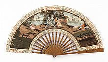 PAPER AND BAMBOO FOLDING FAN Paper leaf with a printed European pastoral scene. Bamboo sticks painted with an abstract design. Front...