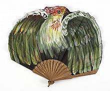 PAPER AND WOOD FONTAGE FAN A colorful painted parrot with green and red feathers and wings extended completely covers the front leaf...