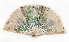 LACE, PAPER, AND WOOD FOLDING FAN Paper leaf painted with flowers, leaves, and butterflies against a silver and iridescent backgroun...