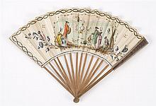 PAPER AND WOOD FOLDING FAN Central vignette illustrates adults in period dress watching children at play. Simple wood sticks. Back g...