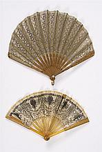 TWO FOLDING SPANGLED FANS a) Spangled net leaf and wood sticks and guards inset with sequins, length 8.5