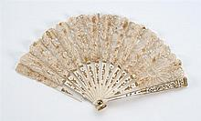 CHILD'S LACE AND BONE FOLDING FAN Lace leaf applied to bone sticks with impressed gold design and inset with piqués. Complimentary g..