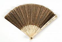 CHILD'S BRONZE MESH AND IVORY FOLDING FAN Numerous pink and gold sequins scattered about the bronze mesh leaf. Ivory sticks and guar..