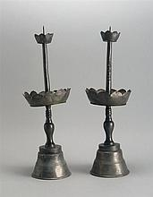 PAIR OF PEWTER PRICKET CANDLESTICKS With circular base and flower-form bobèches. Heights 16.5