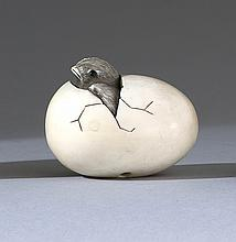 IVORY NETSUKE By Mitsuhiro. In the form of a chick emerging from an egg. Inlaid eyes. Length 1.75