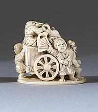 IVORY NETSUKE Depicting an oni, dog, sparrow, and monkey with a wheeled cart. Signed. Height 1.75